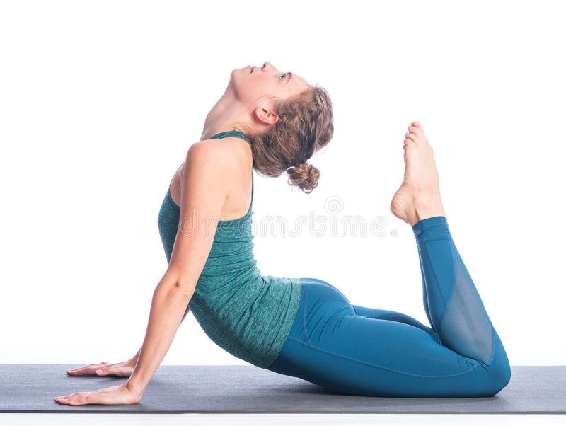 Athletic young blonde woman doing yoga practice isolated on white background. stock photos