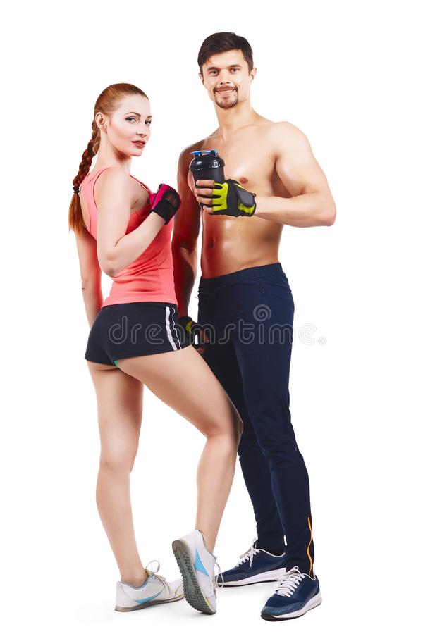 couple, muscular man holding a beautiful woman isolated on stock photography