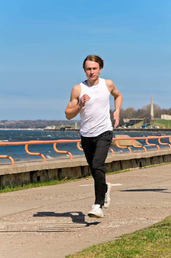 Download Athletic Young Male Running Stock Image - Image: 24613521
