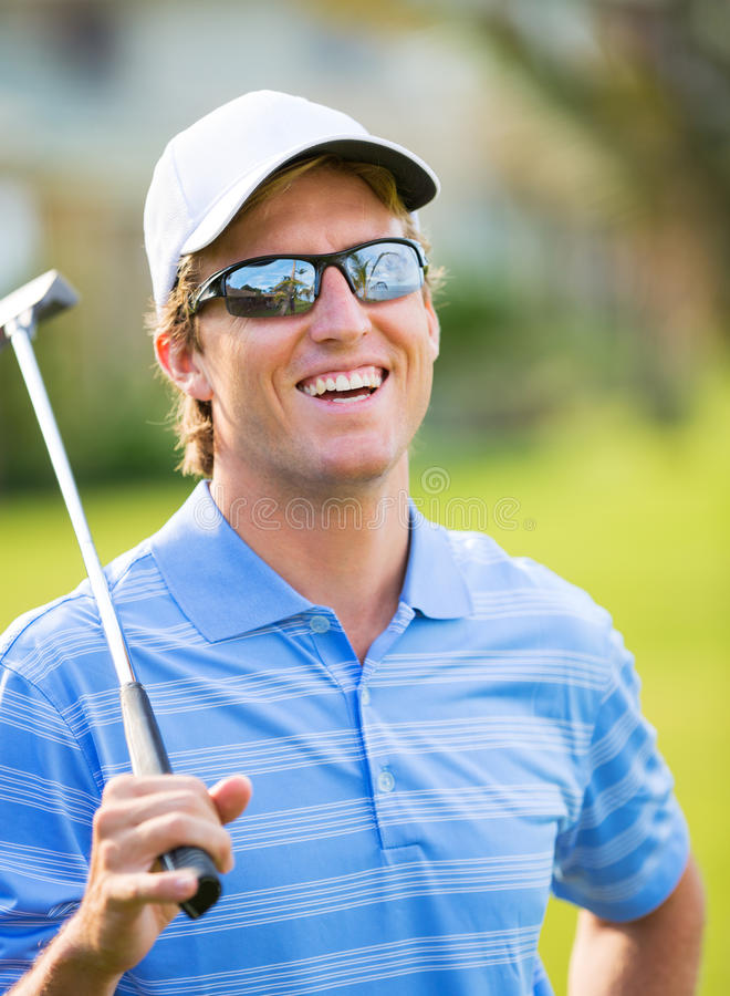 Athletic Young Man Playing Golf Stock Photo