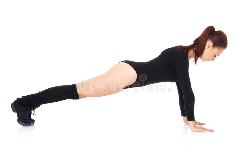 Athletic young woman doing press ups stock images