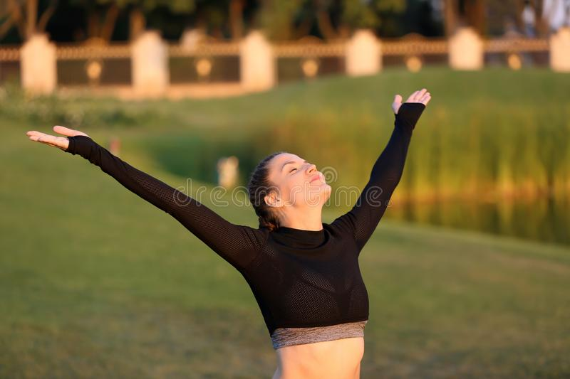Athletic young woman enjoying nature in the morning royalty free stock image