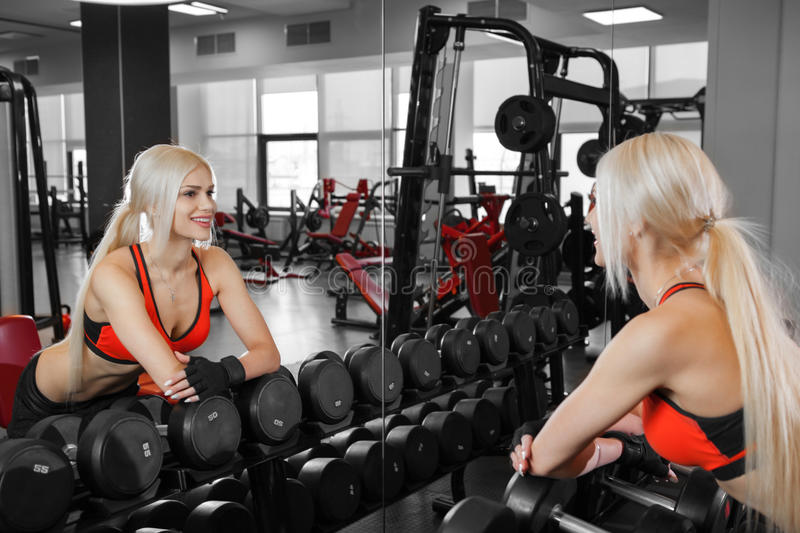 Athletic young woman resting during exercise royalty free stock photos