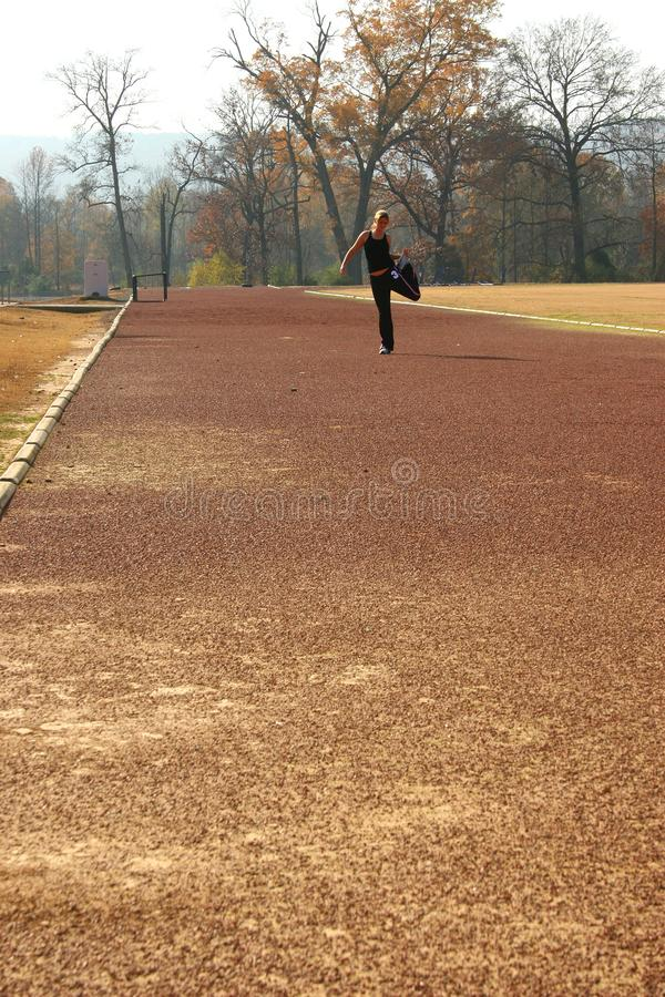 Download Athletic Young Woman Stretching At The Track Stock Image - Image of trees, athlete: 386349