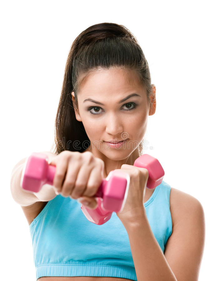 Athletic young woman works out with weights royalty free stock photo