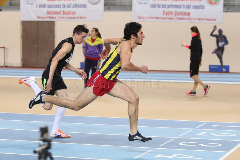 Athletics. ISTANBUL, TURKEY - FEBRUARY 15, 2015: Athletes steeplechase running during Turkcell Juniors and Seniors Athletics Turkey Indoor Championship in Asli stock image