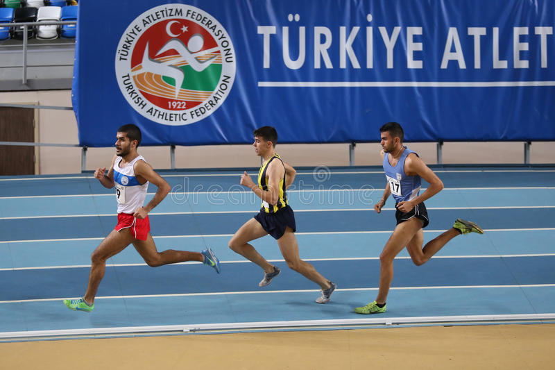 Athletics. ISTANBUL, TURKEY - JANUARY 24, 2015: Athletes run during Turkish Athletic Federation Indoor Athletics Competition in Asli Cakir Alptekin Athletics royalty free stock photos