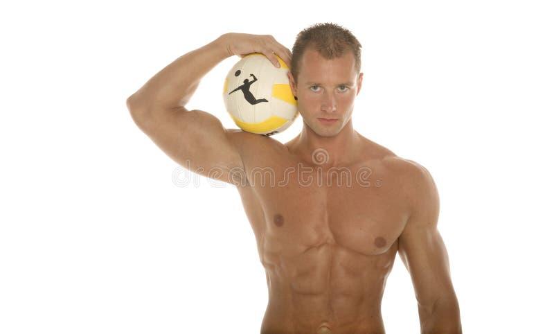 Athletischer Mann mit Kugel lizenzfreies stockfoto