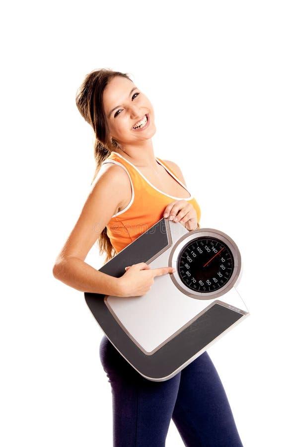 Athletisches Mädchen mit einer Skala lizenzfreie stockbilder