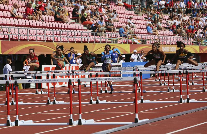 Athlets running 100 metres hurdles semi-final in the IAAF World U20 Championship in Tampere, Finland 14 July, 2018. stock photo