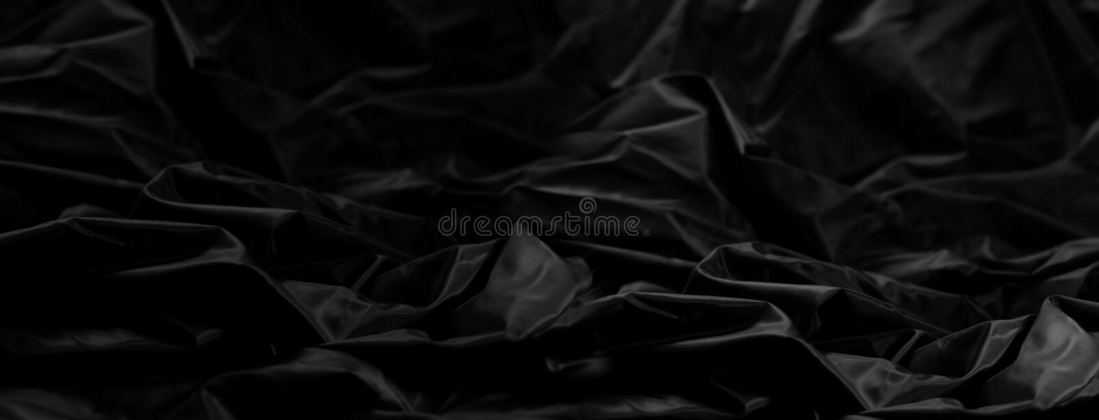 AtinElegant black s silk with waves, abstract background. Elegant black satin silk with waves, abstract background royalty free stock photography