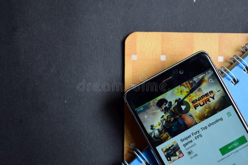 Atirador furtivo Fury: Jogo superior do tiro - colaborador app de FPS na tela de Smartphone fotos de stock royalty free