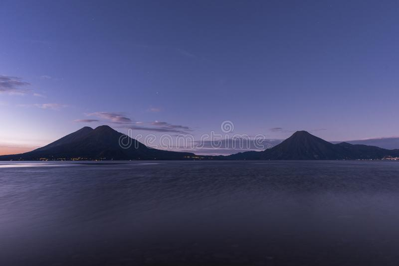 Atitlan Lake in Guatemala. Long Exposure. Volcano in Background. Morning Light. royalty free stock image