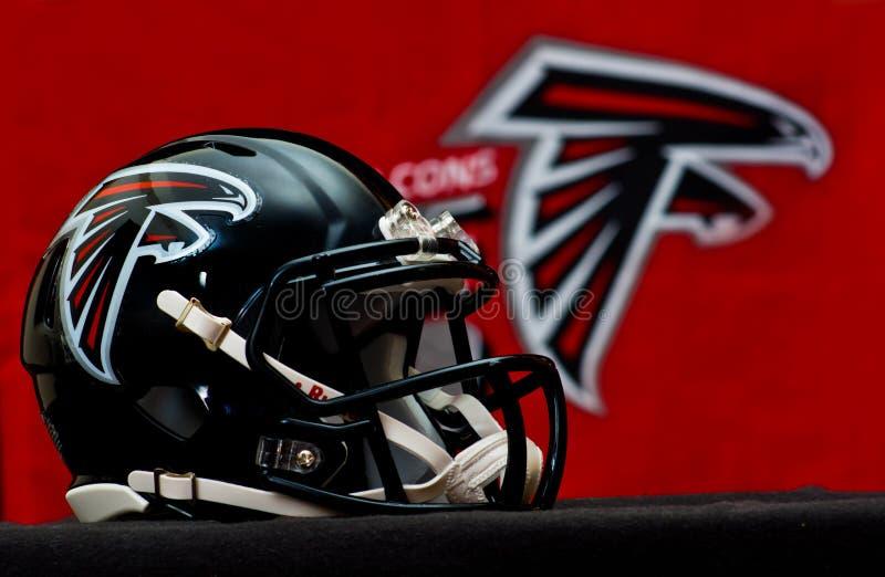 Atlanta Falcons helmet. ZAGREB , CROATIA - NOVEMBER 19 , 2014 : NFL Atlanta Falcons equipment , helmet and flag ,product shot stock photography