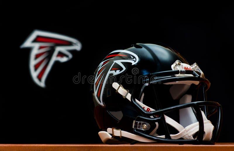 Atlanta Falcons helmet. ZAGREB , CROATIA - NOVEMBER 19 , 2014 : NFL Atlanta Falcons equipment , helmet and flag , product shot royalty free stock photography