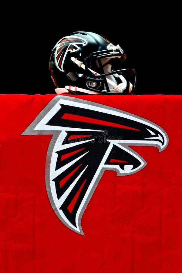 Atlanta Falcons helmet. ZAGREB , CROATIA - NOVEMBER 19 , 2014 : NFL Atlanta Falcons equipment , helmet and flag ,product shot royalty free stock photography