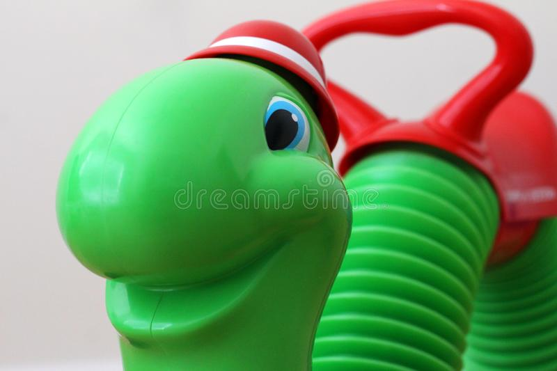 Radio Flyer Inchworm ride-on toy royalty free stock photography