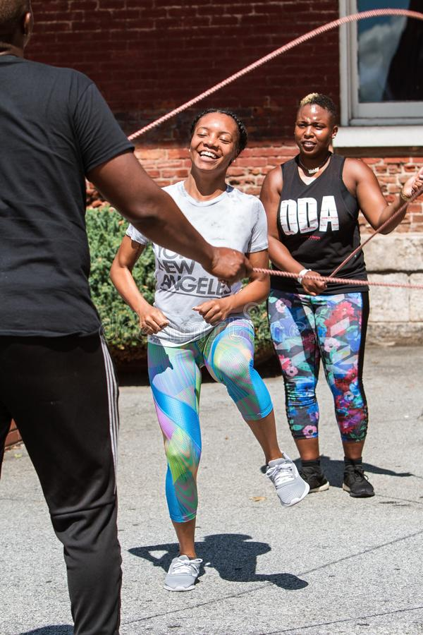 Young Woman Jumps Rope Double Dutch Style At Fitness Event stock images