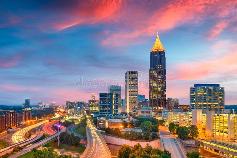 Atlanta, Georgia, USA Downtown Skyline. Atlanta, Georgia, USA downtown and midtown skyline at dusk over highways royalty free stock photo