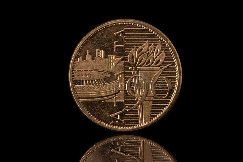 Atlanta 1996 olympics commemorative coin isolated on black. Atlanta 1994 olympics commemorative coin isolated on black royalty free stock photo