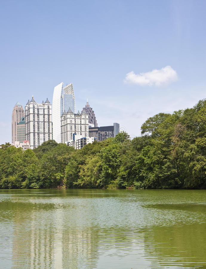 Free Atlanta Towers And Cloud Past Green Lake Stock Photography - 11526902