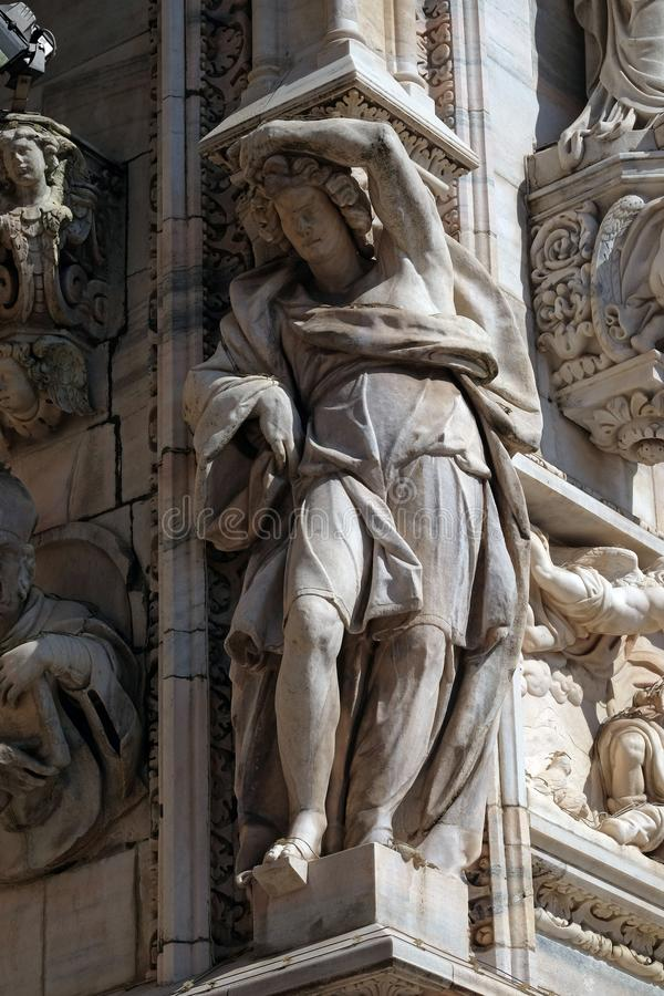 Atlantes supporting the main facade of the Milan Cathedral. Duomo di Santa Maria Nascente, Milan, Lombardy, Italy royalty free stock photography