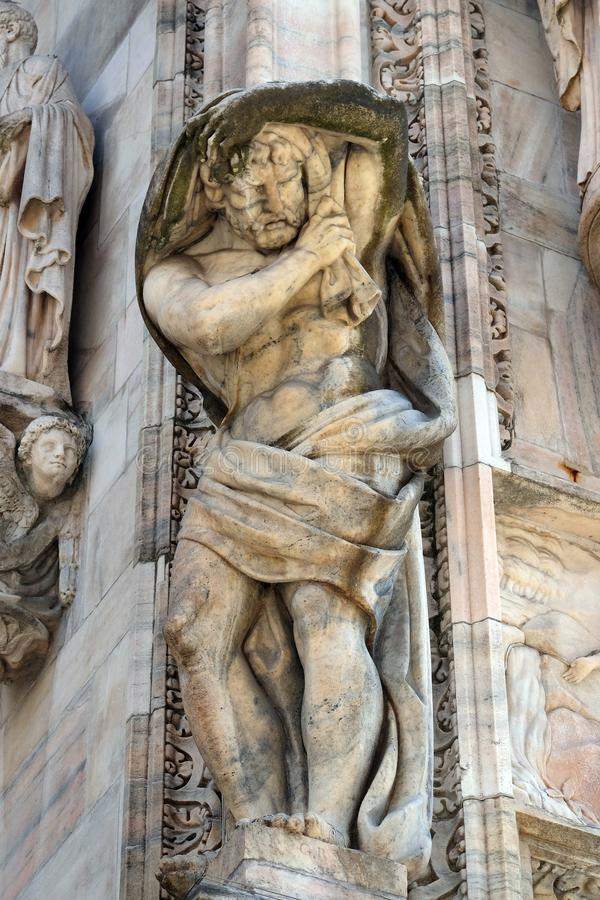Atlantes supporting the main facade of the Milan Cathedral. Duomo di Santa Maria Nascente, Milan, Lombardy, Italy royalty free stock image