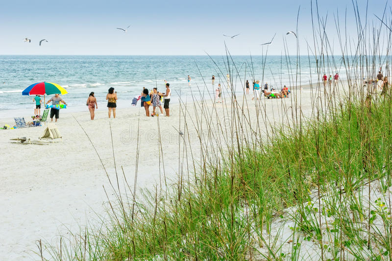 Atlantic Beach. FL - May 23, 2014: Beach goers enjoy a day on the beach during the summer months at  near Jacksonville, Florida stock photography