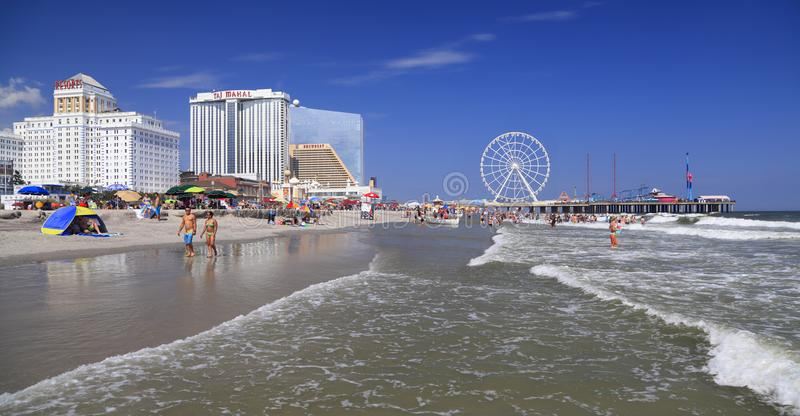 Atlantic City beach and skyline, New Jersey, USA. ATLANTIC CITY, NEW JERSEY - AUGUST 19, 2017: Beach and Steel Pier in Atlantic City. Established in the 1800s as royalty free stock photos