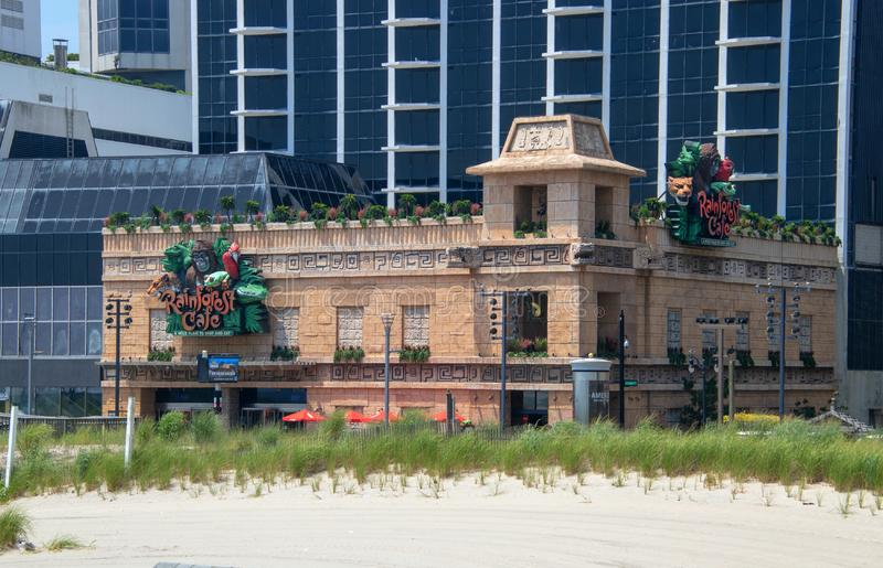 View of the sign and facade of the Rainforest Cafe Restaurant on the boardwalk in Atlantic City, New Jersey stock photography
