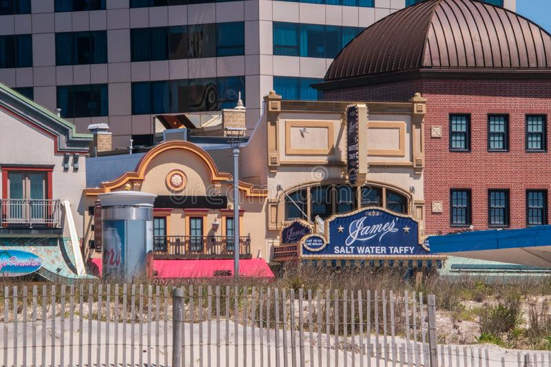 Atlantic City, New Jersey - May 24, 2019: View from the beach of the facades of several stores on the Atlantic City Boardwalk. The royalty free stock photography