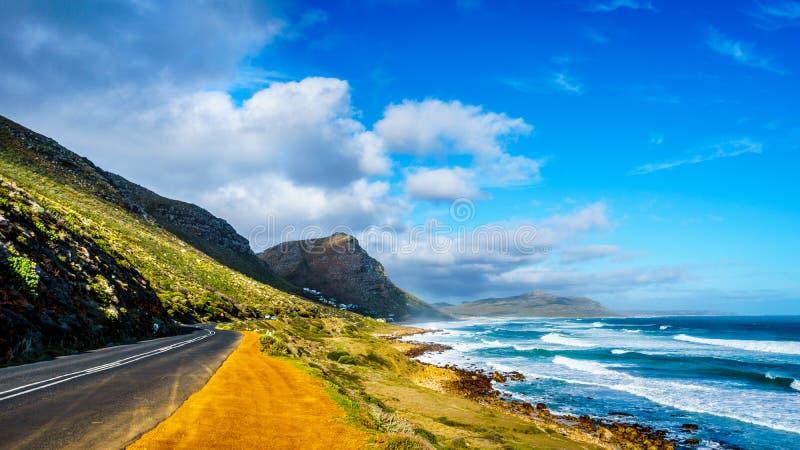 The Atlantic coast along the road to Chapman`s Peak at the Slangkop Lighthouse royalty free stock photos