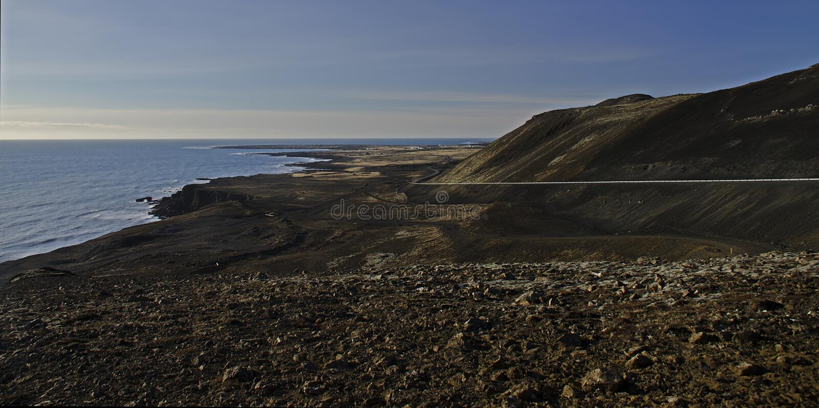The Atlantic coast with black sand and huge lava rocks. In Iceland, beach, beautiful, cliff, coastline, landscape, nature, ocean, sea, seascape, shore, sky stock photo