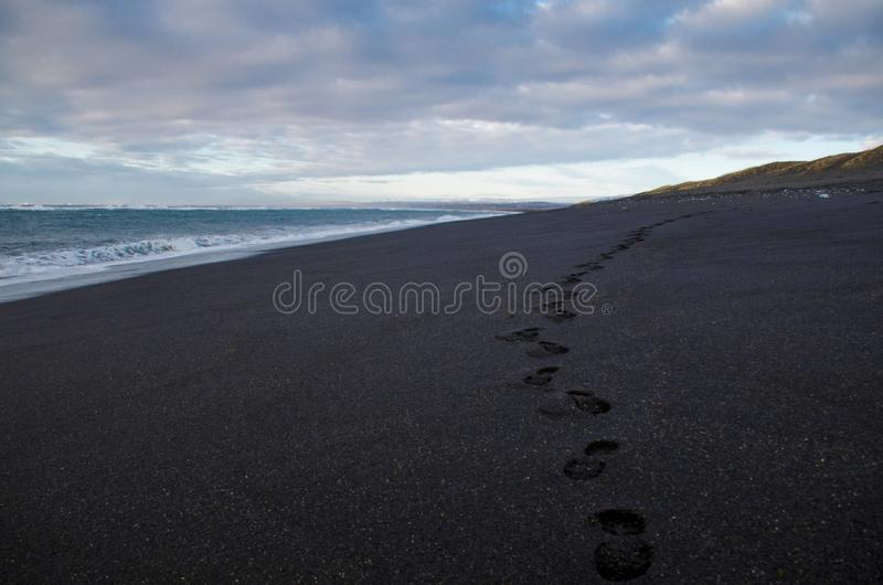 The Atlantic coast with black sand and huge lava rocks. In Iceland, beach, beautiful, cliff, coastline, landscape, nature, ocean, sea, seascape, shore, sky stock images