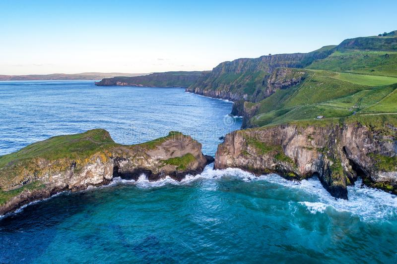 Atlantic coast in Northern Ireland with cliffs at Carrick-a-Rede rope bridge royalty free stock photography