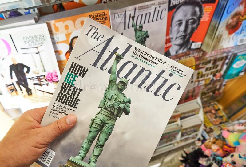 The Atlantic magazine in a hand stock photos