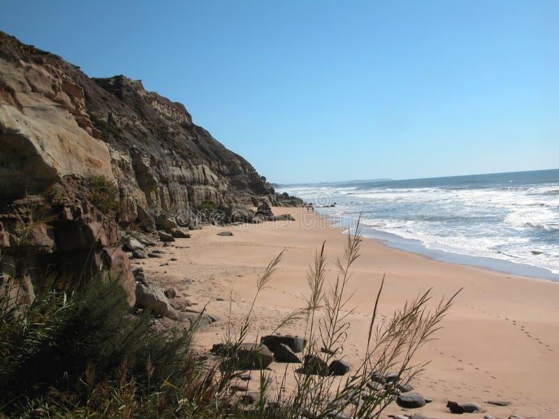 Atlantic Ocean coast. The Atlantic Ocean rocky coast in the summer. Sandy beach royalty free stock photos