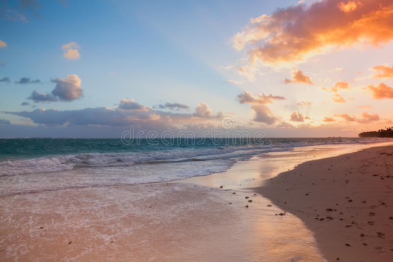 Atlantic Ocean coast, Bavaro beach. Orange sunrise over Atlantic Ocean coast, Bavaro beach, Hispaniola Island. Dominican Republic, coastal landscape royalty free stock images