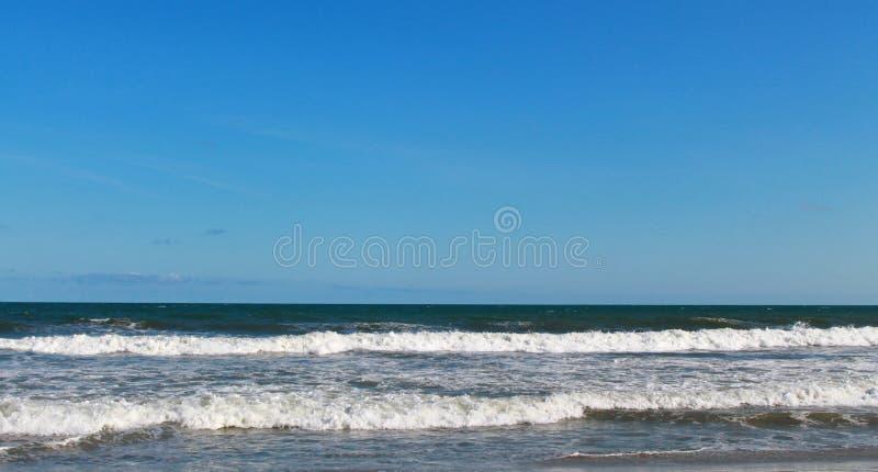 Atlantic Ocean Folly Beach SC. Waves crashing on Folly Beach from the Atlantic Ocean in the day time royalty free stock images