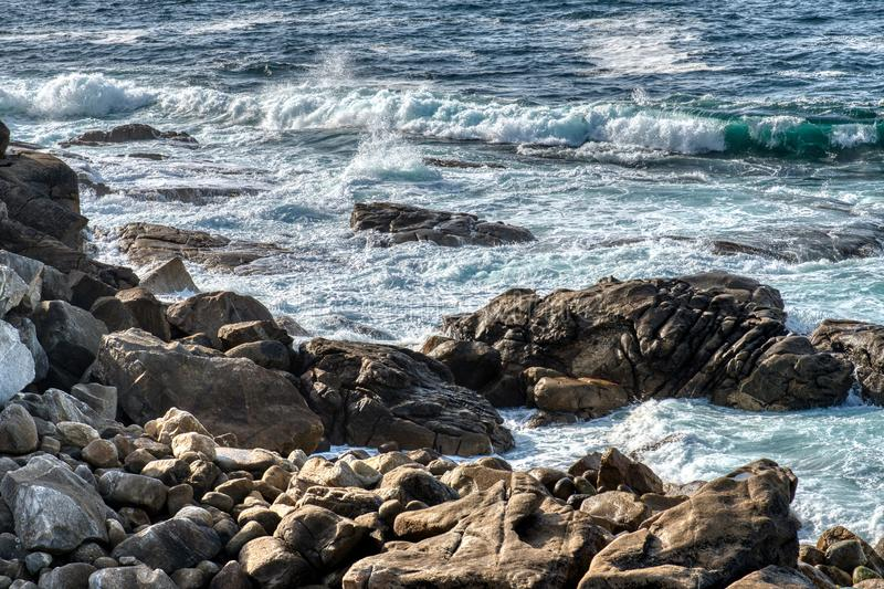 Atlantic Ocean. Pacific ocean waves crashing on rocks foaming in the water royalty free stock images