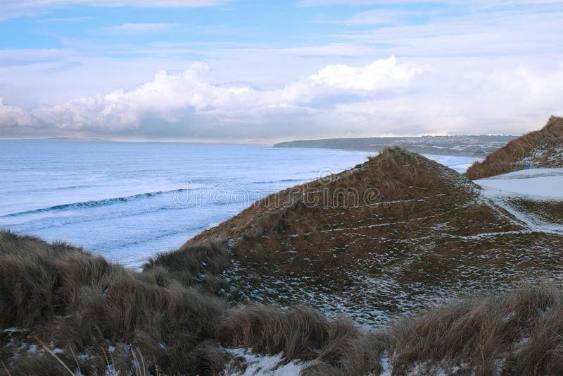 Atlantic ocean beside a snowy golf course stock photo