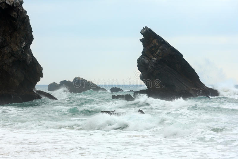 Atlantic ocean storm, Portugal. Atlantic ocean waves breaking on granite boulders near beach in stormy weather Cabo da Roca, Portugal royalty free stock photo