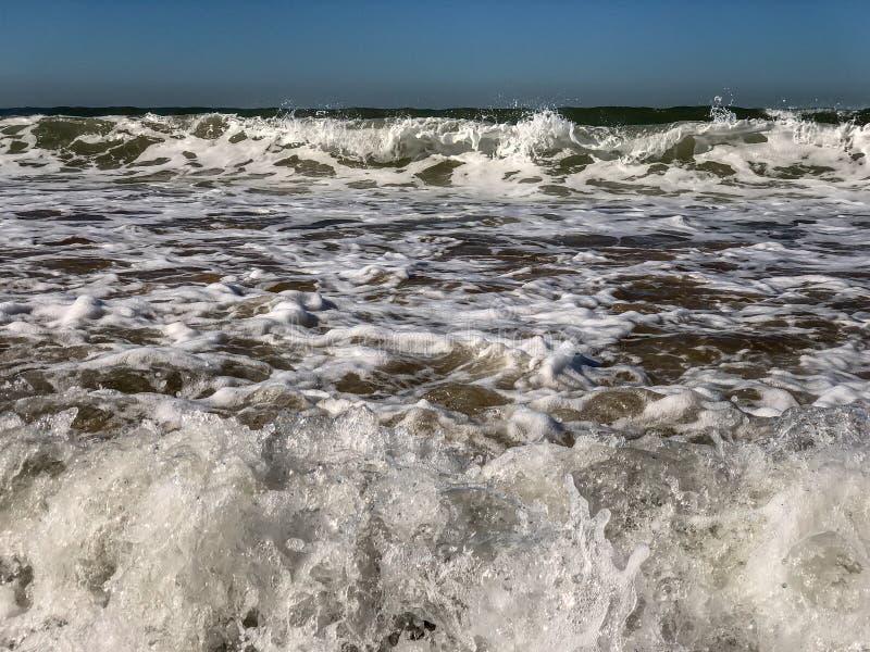 Atlantic Ocean waves breaking on the sand beach at Agadir, Morocco royalty free stock photo