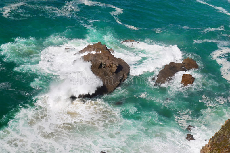 Atlantic Ocean Waves Crashing on Rocks. Cape Cabo da Roca. Atlantic ocean waves crashing on the rocks, view from cliff. Coastline, Portugal royalty free stock images