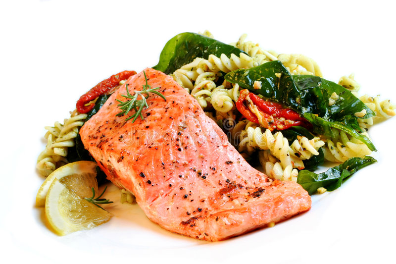 Atlantic Salmon and Pasta Salad. A fillet of Atlantic salmon, perfectly cooked, with a fresh pasta salad stock images