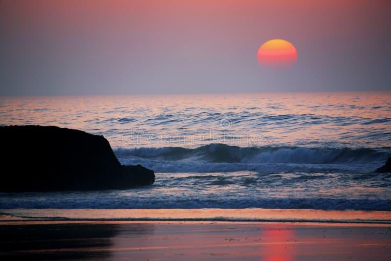 Atlantic sunset. Sunset at the Atlantic Ocean, Legzira Beach, Morocco, Africa stock photos