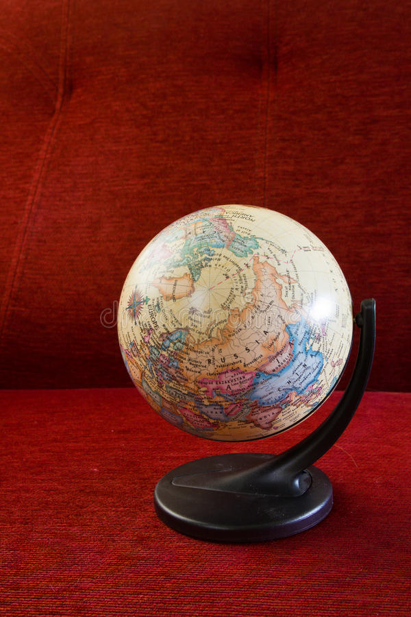 Atlas Globe. Inflatable atlas globe on red chair stock photography