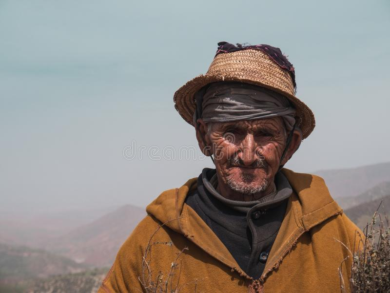 ATLAS MOUNTAINS, MOROCCO - March 28, 2018: Portrait of an old man in the Atlas mountains selling herbs royalty free stock images