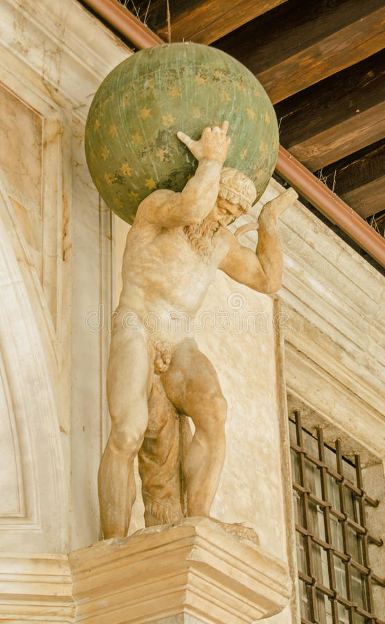 Atlas statue, Venice. Small Renaissance statue of the mythological character Atlas, carrying the world on his shoulders. Exterior of the historic Doge& x27;s stock photos
