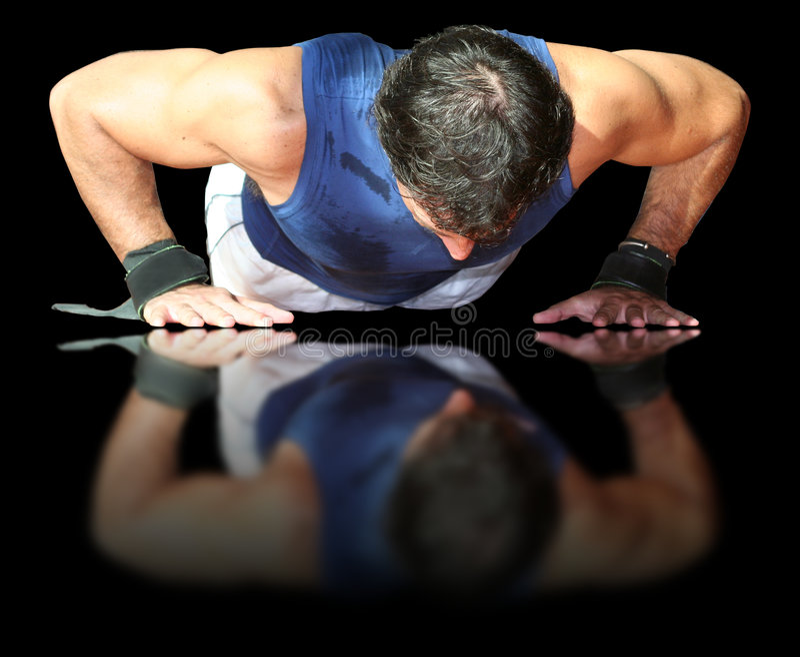 Atleet in de Spiegel stock fotografie